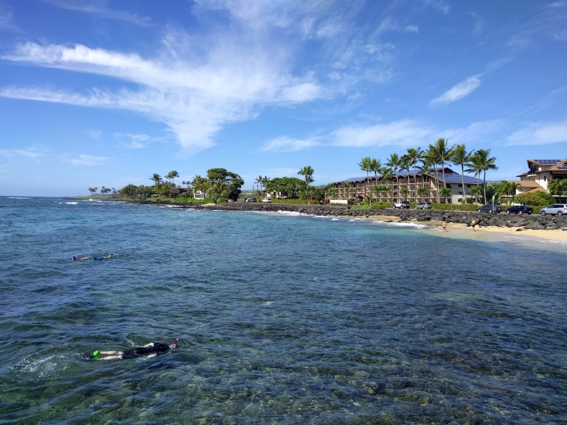 Snorkelers with Lawai Beach Resort in the Background