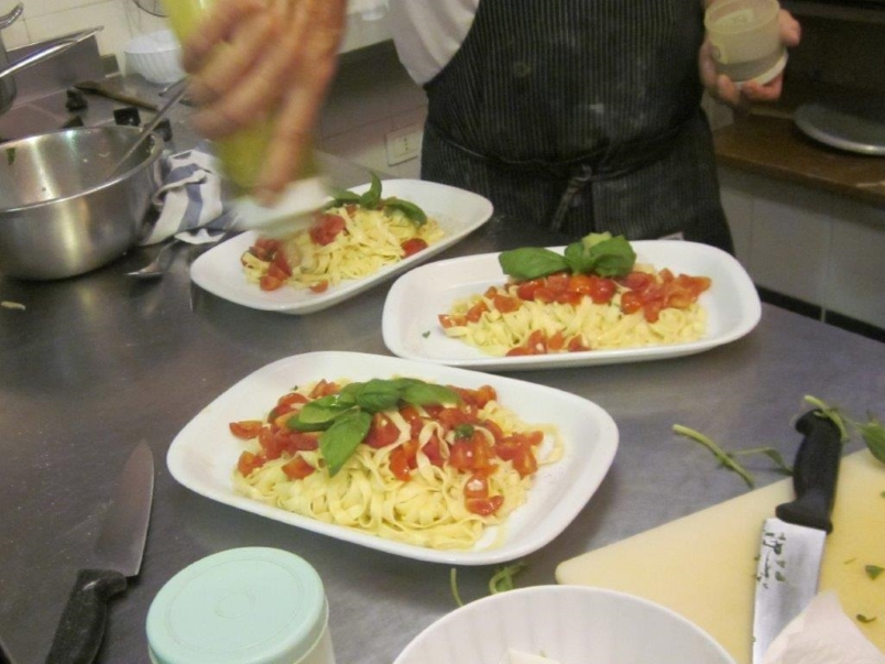 Italy - platters of fresh pasta with tomatoes and basil