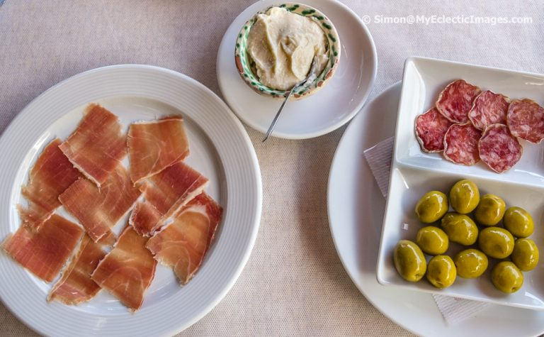 An Appetizer of Serrano Ham, Salami and Olives
