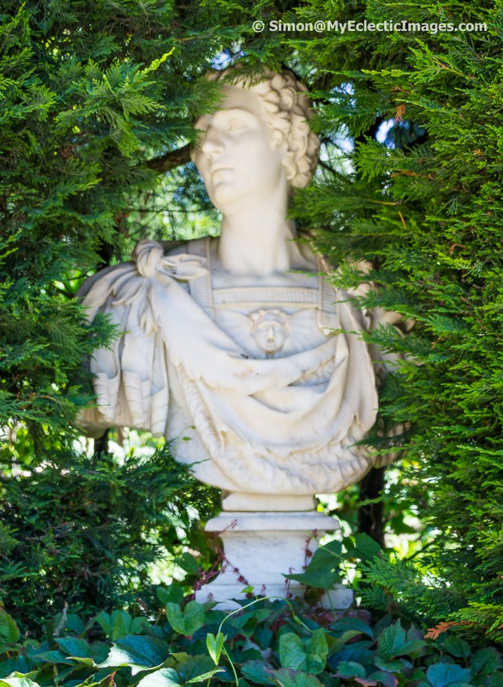 Roman style sculpture buried in greenery - Santa Clotilde Gardens