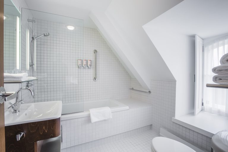 The sleek, clean baths of the contemporary rooms - Le Monastere