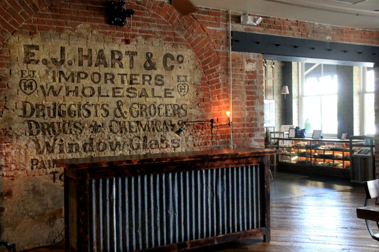 Original painted brick sign at Old 77 Hotel and Chandlery