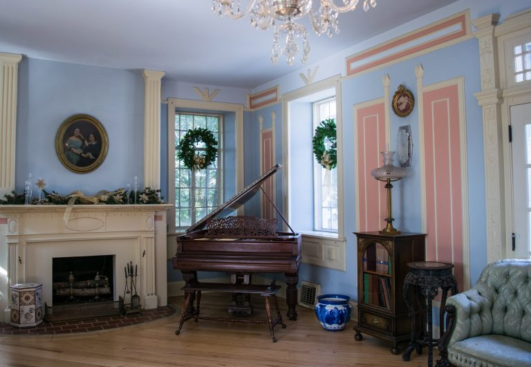 Interior of Burritt Mansion, designed in X-shape with tall windows