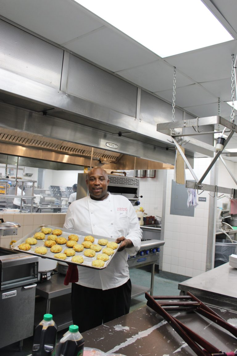 Chef Desmond Marshall with crabcakes at Sandals Barbados