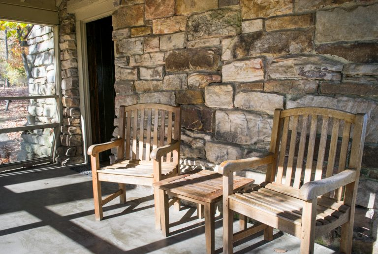 Rocking Chairs on Screened Porch at Rustic Cabin Monte Sano State Park