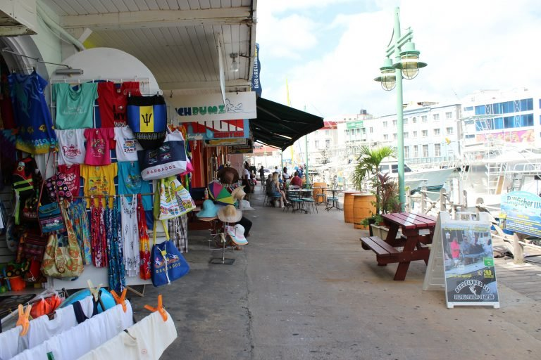 Colorful boutiques and cafes line the Careenage in Bridgetown