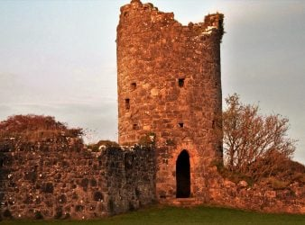 The stones of Crom Castle dyed pink by the sunset