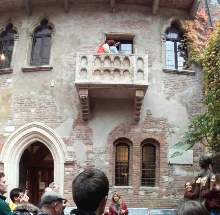 Tourists gazing up at Juliets balcony Verona