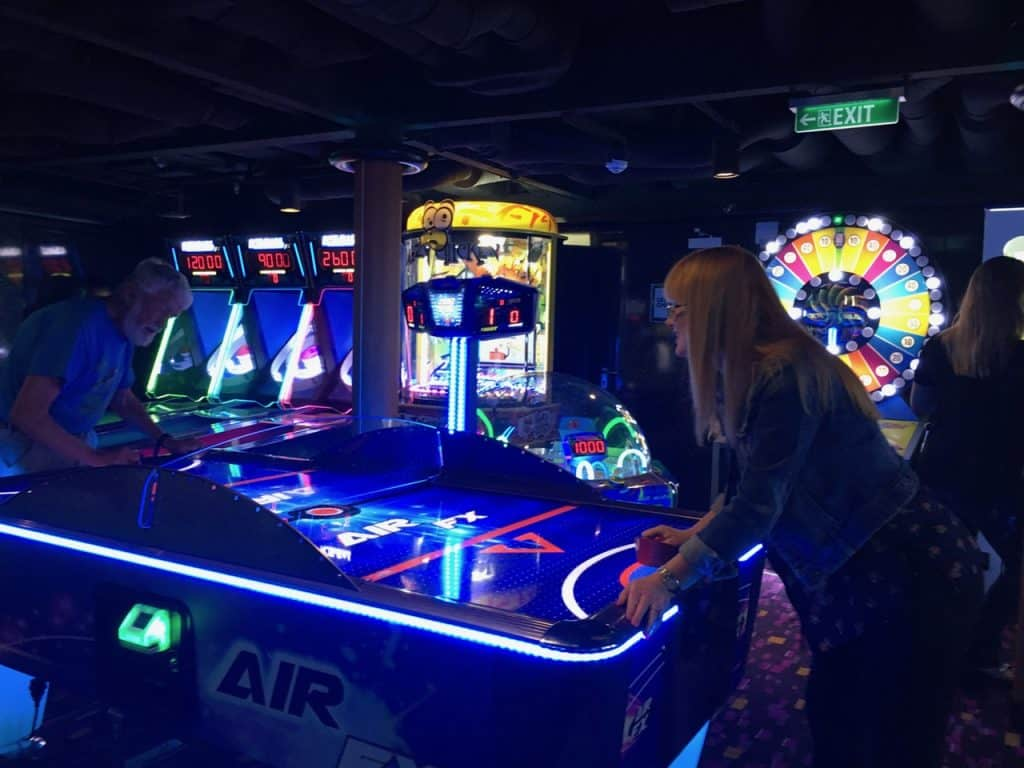 Hollin playing Air Hockey on NCL Escape