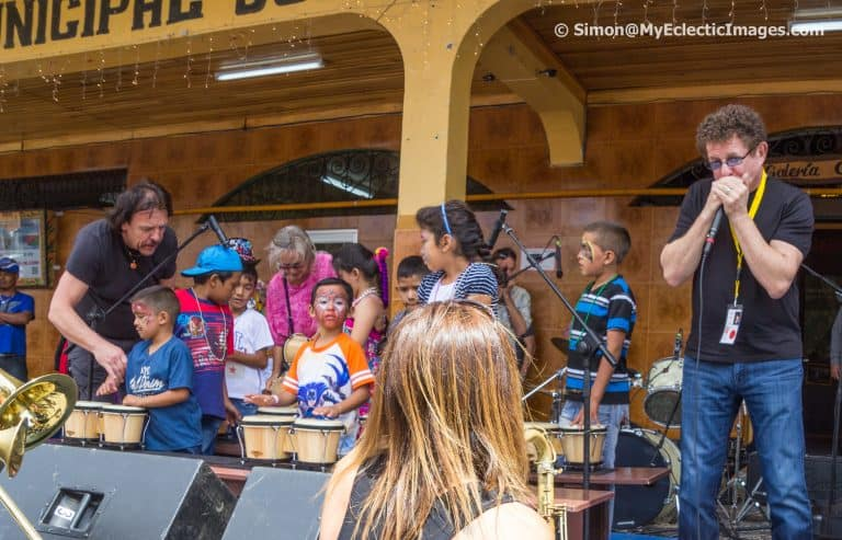 Lee Oskar Playing Harmonica with the Children's Band in Central Square Panama