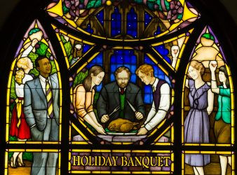 Stained glass window representing holiday banquet in chapel of Cowles Hall