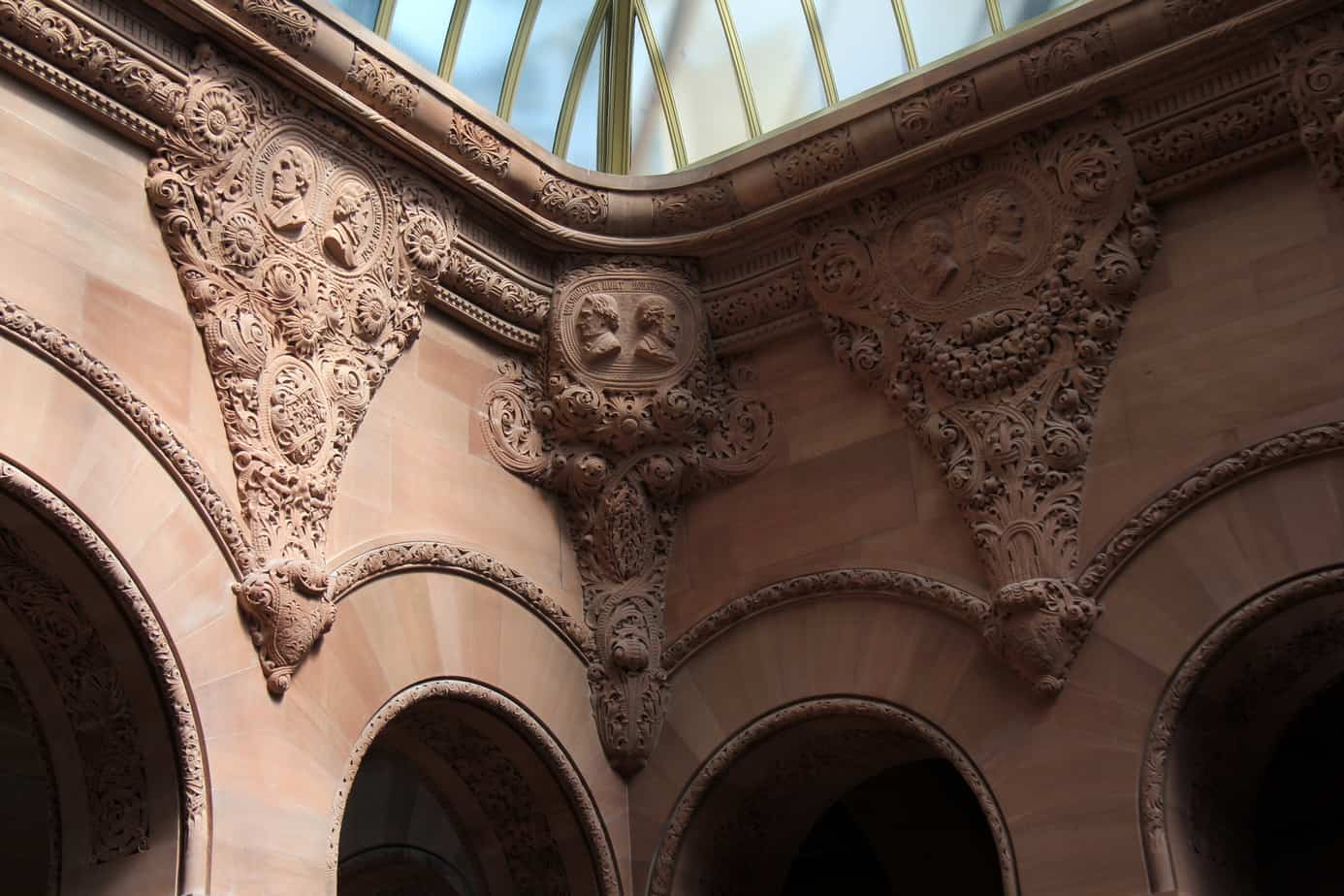 Faces in the vaulted ceiling stonework New York State Capitol