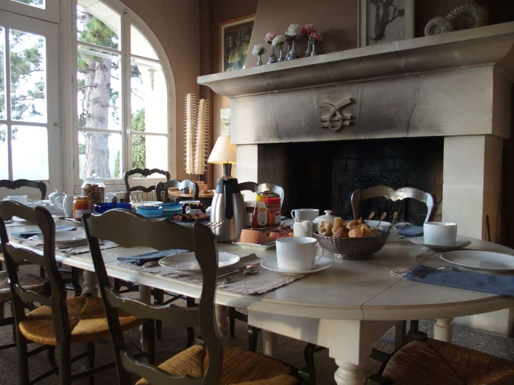 Breakfast by the fireplace at La Couronne
