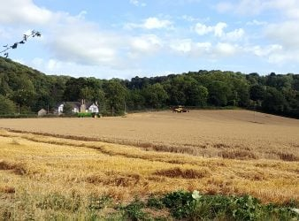 Wythall Estate and Lower Wythall across a field of hay in Ross-on-Wye England