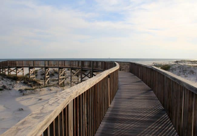 Long Wood Pier Leading Down to the Beach from Beach Club Resort and Spa
