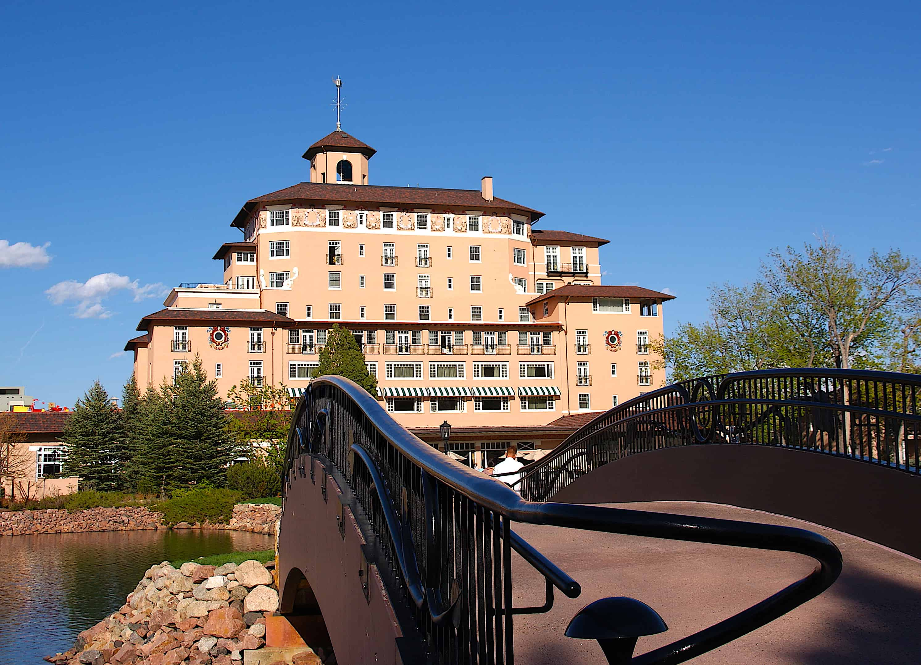 Looking at the Broadmoor hotel in Colorado Springs from across the foot bridge.