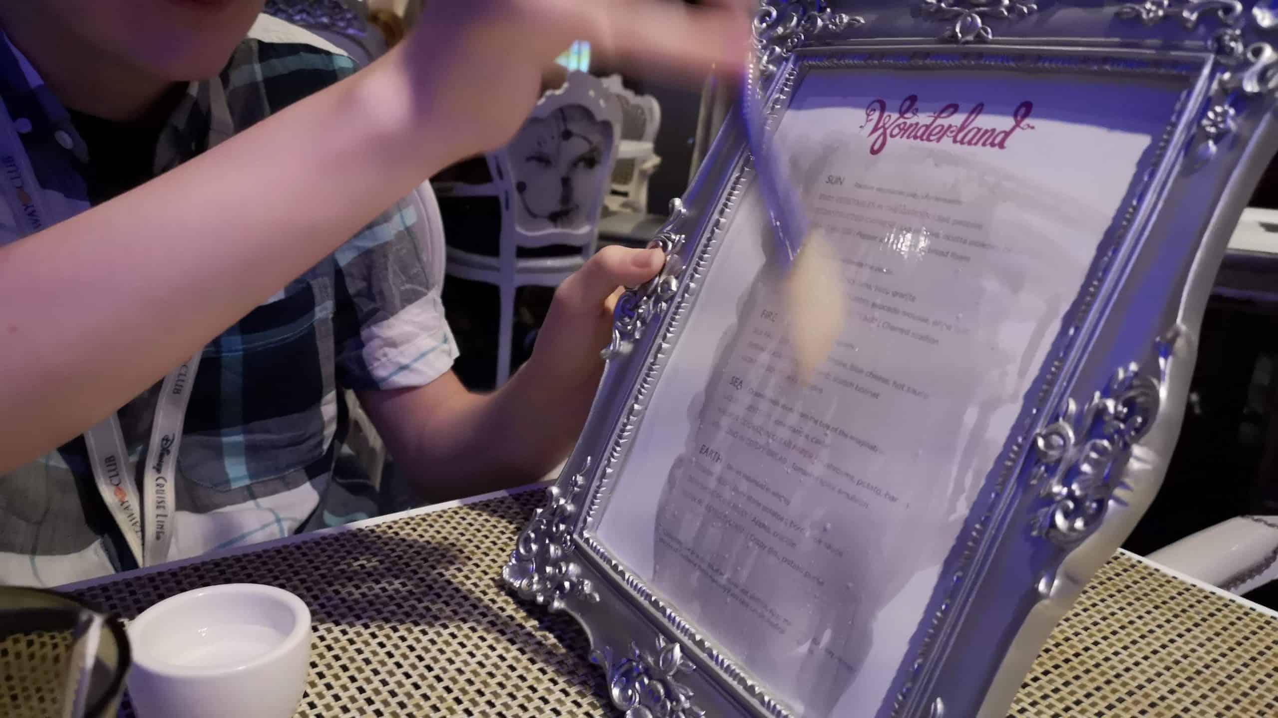 Wonderland menu being painted on