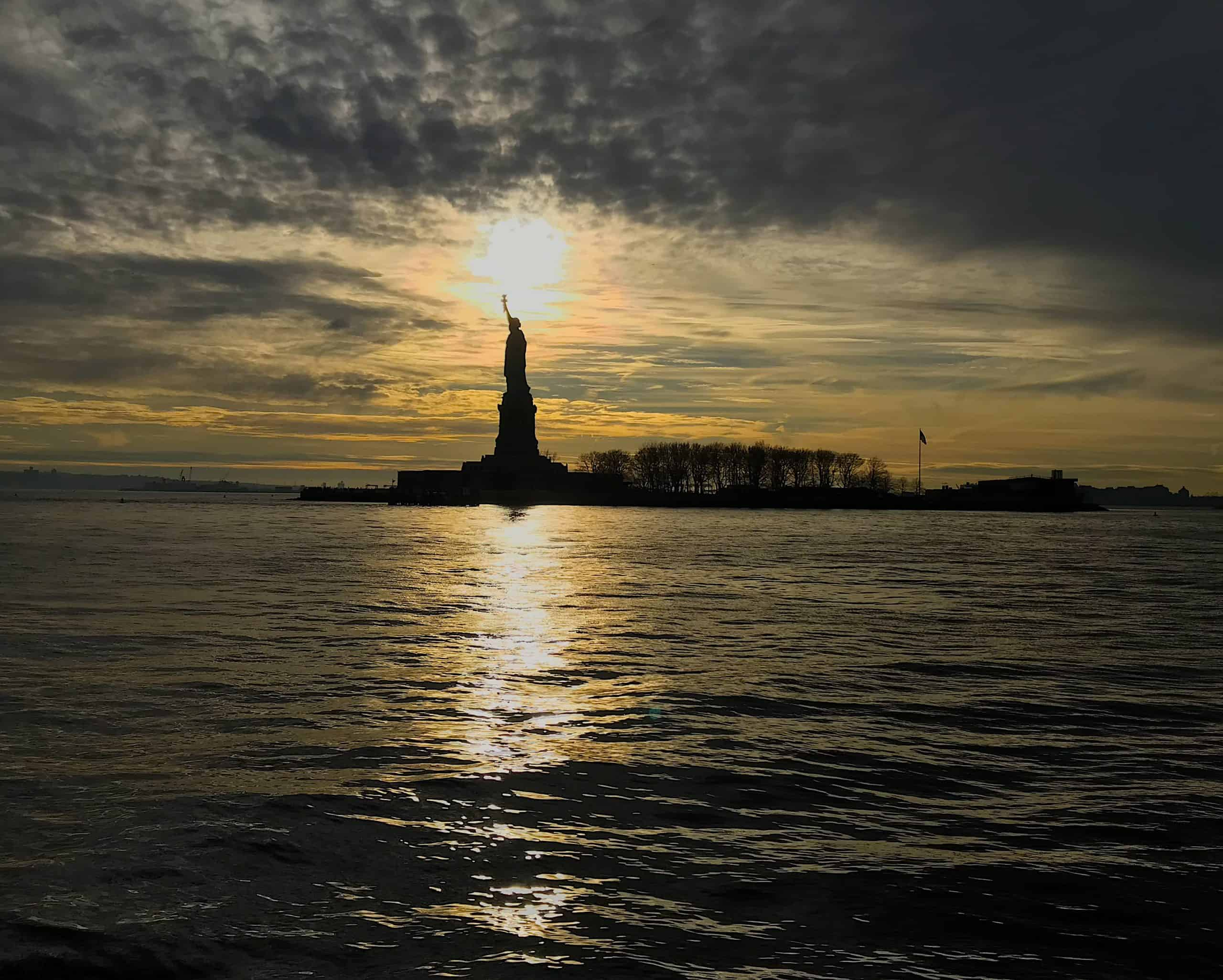 Statue of Liberty at Sundown Midtown Manhattan